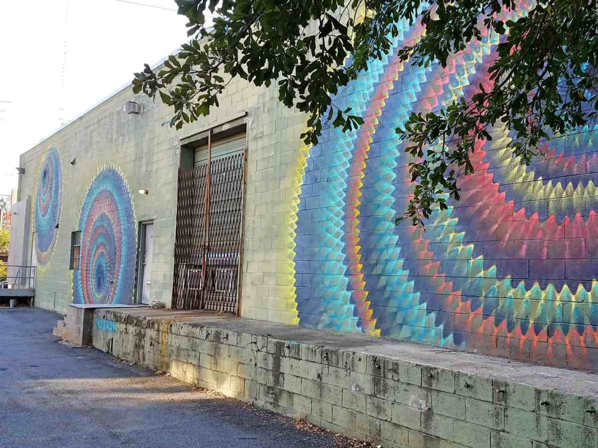 street art featuring multi-colored circular patterns by artist Hoxxoh