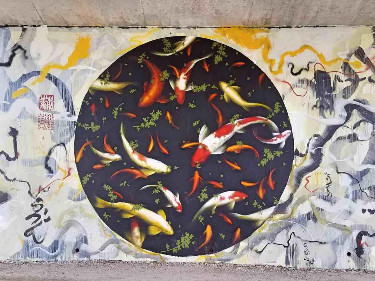 Mural featuring koi fish by artist Brandon Sadler in Midtown Atlanta