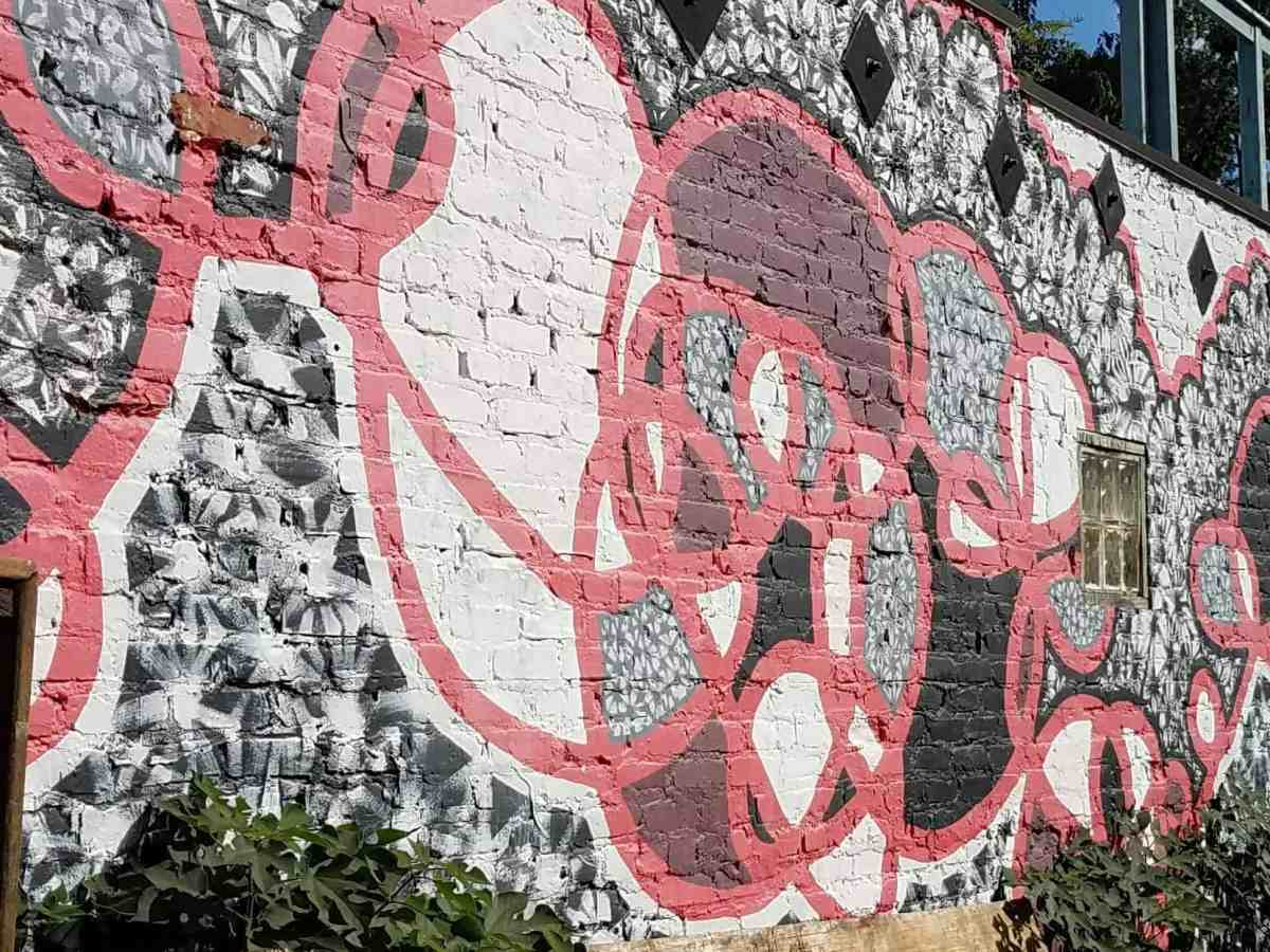 Mural of a red and grey pattern by Molly Rose Freeman