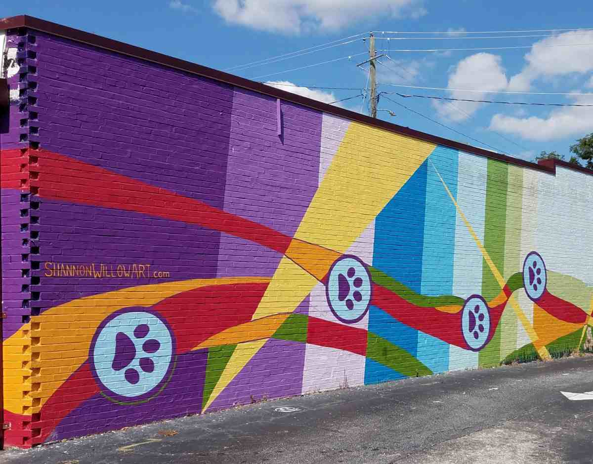Mural featuring vertical bands of color by artist Shannon Willow