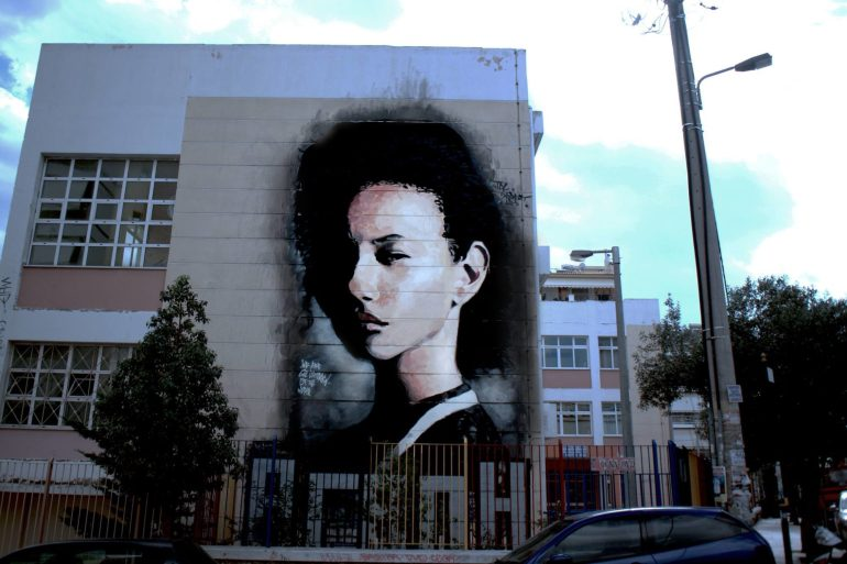 Despite the Challenges JDL paints a mural about peace in Greece