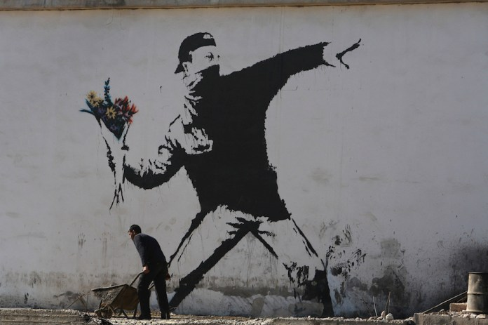Banksy Graffiti Art On West Bank Barrier