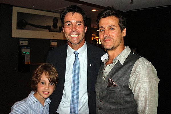 Eric Hoskins, flanked by his son Rhys, left, and Our Lady Peace frontman Raine Maida