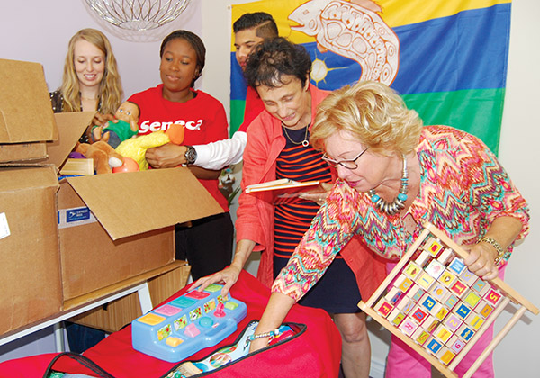 YES THEY CAN: From left, Yes I Can teacher Sasha Rizo, Seneca College students Jamelia Gay and Eric Teekharam, the Seneca early childhood education program's Mary Fisher and Yes I Can executive director Janet MacDougall sort through toys and books headed to the Big Trout Lake reserve in northern Ontario.