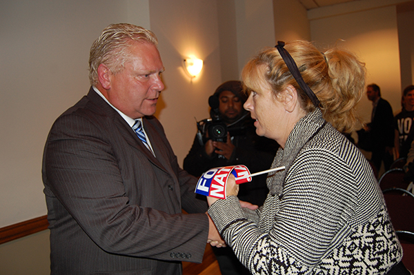 Cancer survivor Karen Hubert greets Doug Ford
