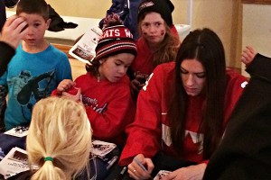Natalie Spooner signs autographs