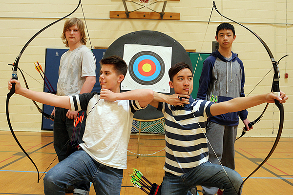 Members of the OFSAA gold medal archery team, Joshua Beech, left, Mike Avrakh, Thinh Ho and Kyle Chan set their sights on the future after claiming the team's third straight gold.