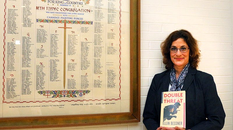 Ellin Bessner with her book about anti-Semitism during World War II