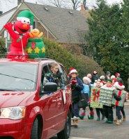 Elmo and kids in Beaches Santa Claus Parade