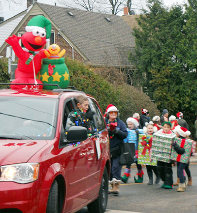 Elmo and kids in Beaches Santa Claus Parade