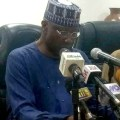 Boss Mustapha announcing travel ban