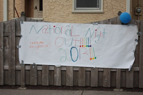 A cheery sign welcomes neighbors to the block party at Portland and