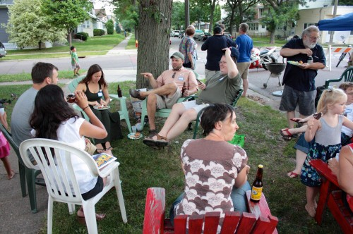 Neighbors chat and enjoy food and beverages in front of Shawna Klatt's house at 1283 Edmund.