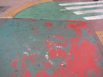 In 2005, the residents voted to change the color of bike paths from red to green. Some red still shows through.