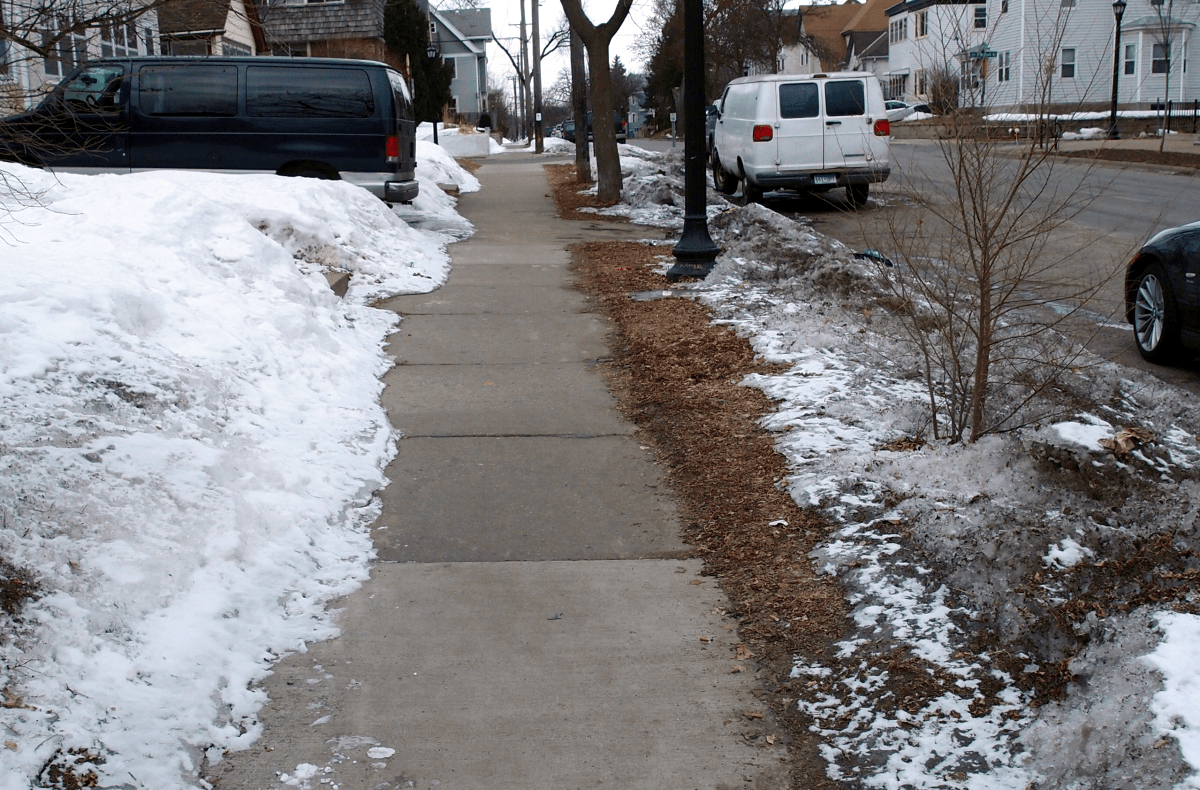 a next year s resolution on sidewalk ice pedestrian safety i ve seen prettier jobs but this property owner is still a hero
