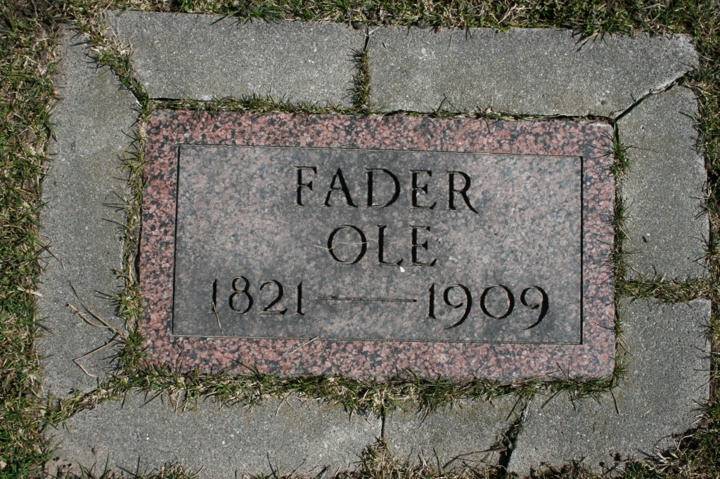A simple in-ground marker at Urland Lutheran Church.