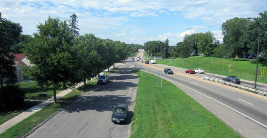 The transition of Cedar Ave from freeway to neighborhood street, across Lake Nokomis. Photo by Bill Lindeke.