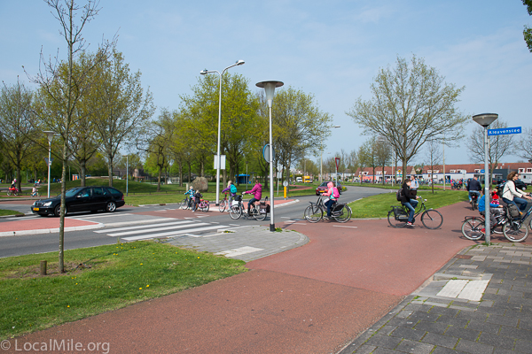 children riding bicycles in netherlands