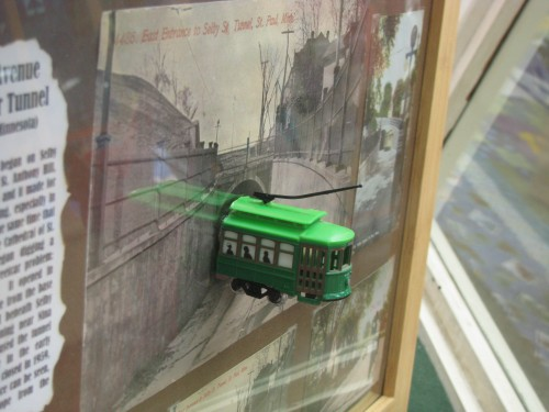 Toy streetcar in frame of streetcar tunnel postcards