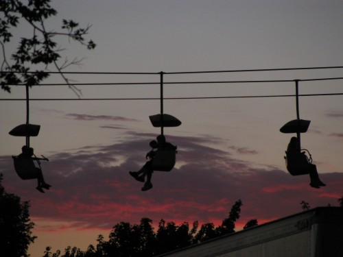 SkyGlider riders against the sunset
