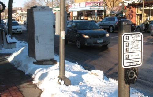 The utility box, poles and street furniture obscures driver's view of pedestrians about to cross the street.