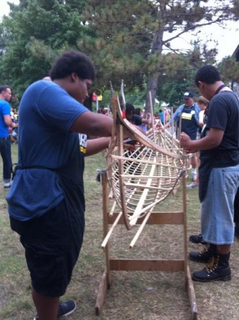 High school students building a canoe