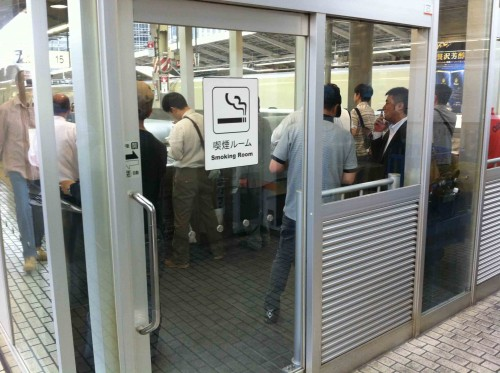 A smoking booth at Tokyo's main station. The smoke is vented away.