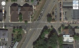 An intersection such as this in downtown White Bear Lake could easily be replaced with a two-lane roundabout and all turn lanes eliminated. In Europe this might be a single lane roundabout with hiway 61 reduced to one lane in each direction. Either option would allow ample right-of-way for bicycle paths and sidewalks and would make crossings much safer for everyone.