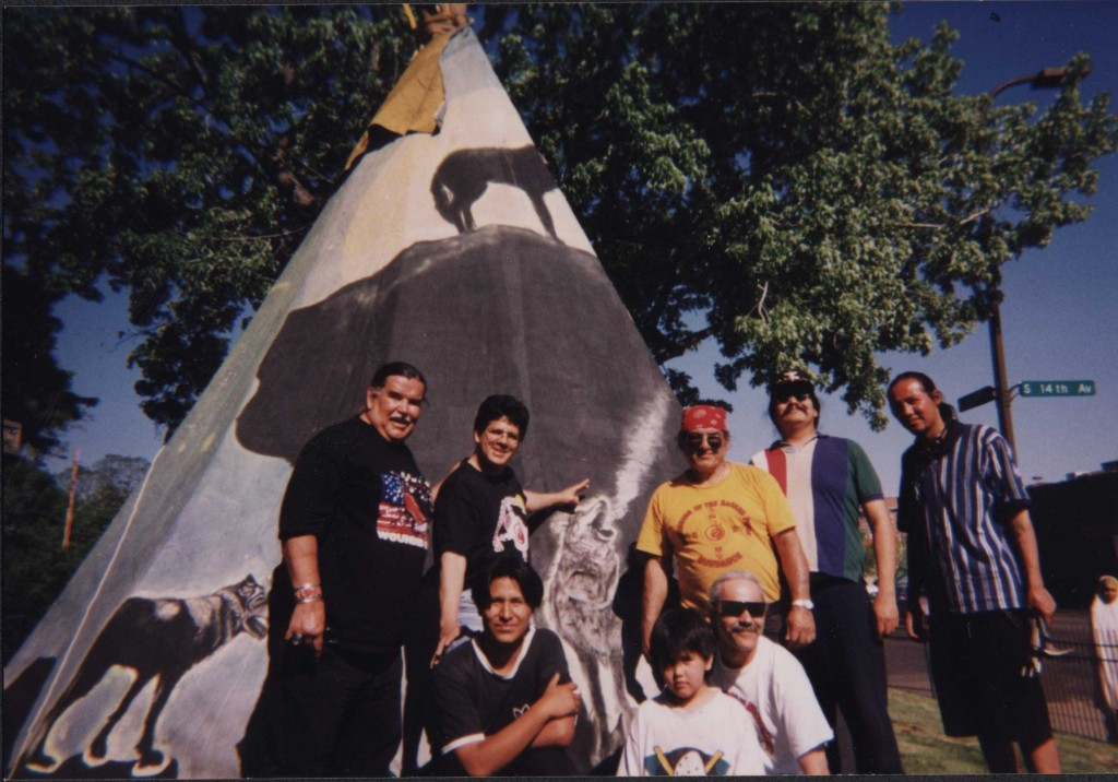 The library lawn was the site for an Honor Village recognizing the library's connection to the local Native community, 1998.   Clyde H. Bellecourt at far left.