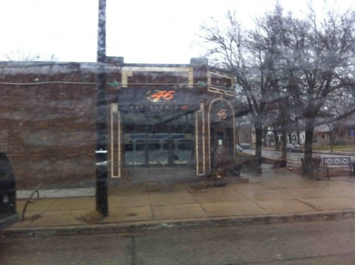 46th and Grand, viewed through a rain-streaked bus window.