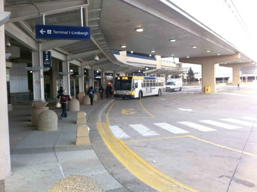 The airport bus station, at the other end of the Terminal 1 parking ramp, directly above the LRT station. That's the #54 to downtown St. Paul.