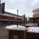 Twin Cities Premium Outlets, a plaza in the snow.