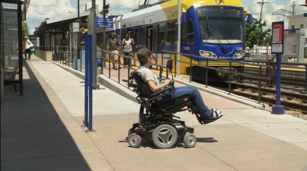 Image of person in wheelchair waiting to board light rail
