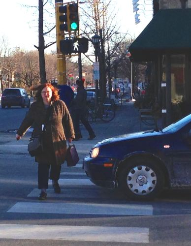 Woman crossing Selby at Snelling