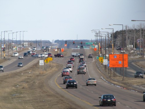 Bent Straw Installation on MN 36; some of the shoebox luminaires are being replaced with conventional ones.