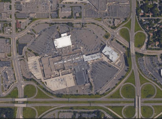 Satellite image of Rosedale. Existing parking decks are beige color on SW corner. (Image: Google Maps)
