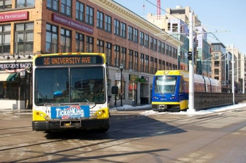 OK, this is not one of the transfer points in the article, but it was the only photo I could find with both a bus and Green Line train.