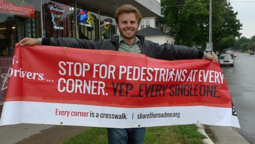 Carrying the banner for pedestrian safety at a crosswalk event in August 2015