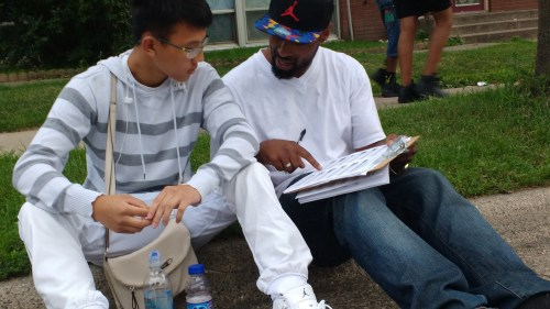 Tescil working on a survey with Deveon Thao