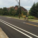 Bike lane in front of Francis Cabrini is striped eastbound, not westbound. A confident bicyclist takes the road anyway.