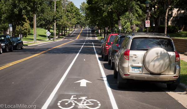 New Cleveland Avenue bike lanes in St Paul. Similar to some in Portland though narrower parking so cars more likely to intrude in bike lane, narrower bike lane, no buffer, wider motor traffic lane, and higher speeds.