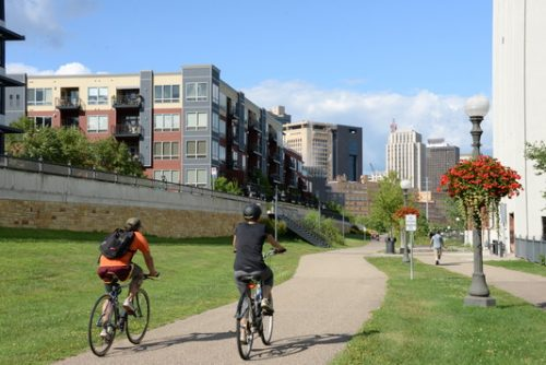 People on bicycles on the Sam Morgan Trail near the Upper Landing housing development along the Mississippi River just upriver from downtown Saint Paul.