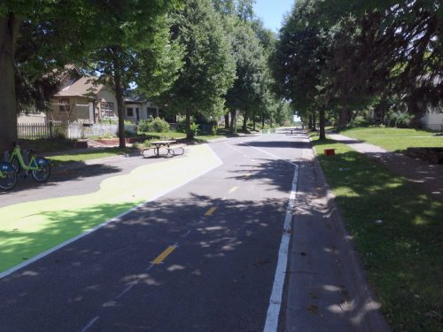 "A street in North Minneapolis closed off to traffic. In theory, it could be ""un-paved."""