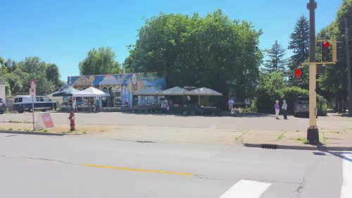 """The Farmers' Market in the Lot of Gustavus Adolphus Lutheran Church (""""To Build Community …"""")"""
