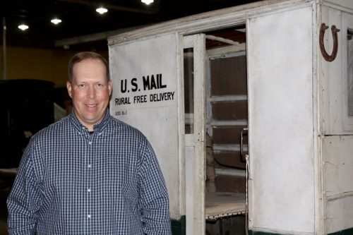 Dan Cagley in front of a horse drawn U.S. Mail delivery wagon.