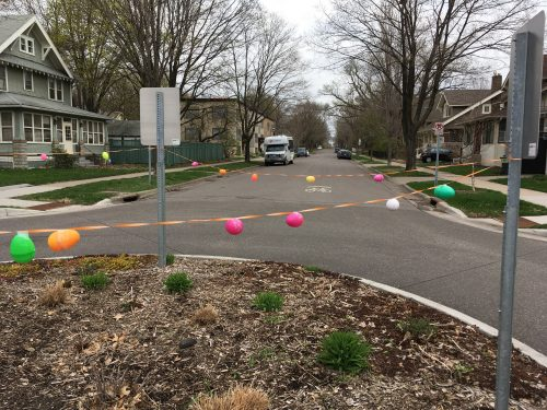 A traffic circle is lined with plastic colorful Easter eggs