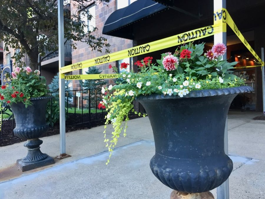 Caution tape and flower urns