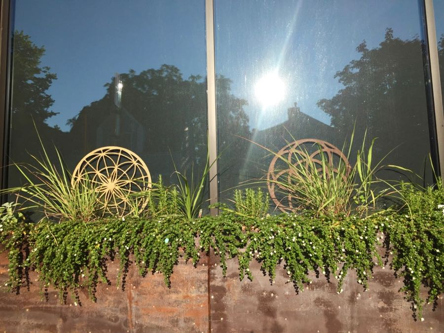 Window box with greenery and decorative sculptures