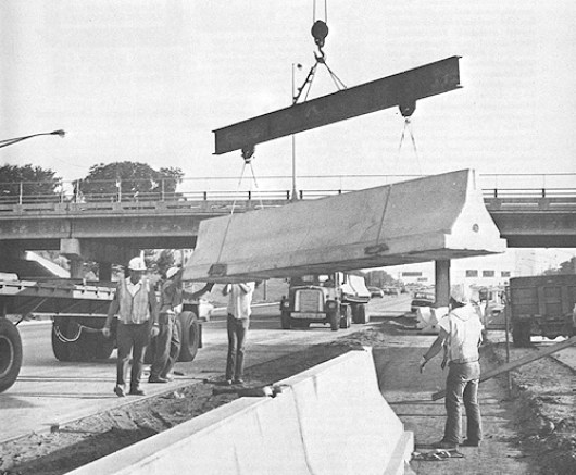 Putting in newly developed Jersey barriers on I-35W, early 1970s.