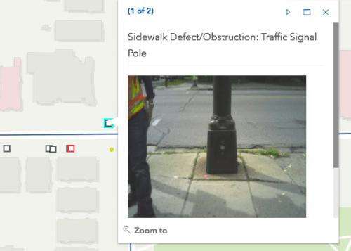 Light pole barrier in the sidewalk